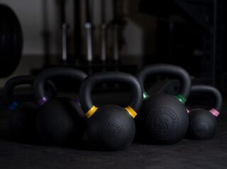 A must have for every gym: kettlebells. Versatile, challenging, and minimal. Ours feature: ✔️ Single-piece casting ✔️ Smooth matte black powder coat finish for grip, durability, & protection  ✔️ Color-coded handles ✔️ Recessed logo for safety ✔️ Sold in a set or individually